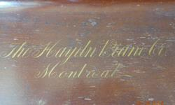 The Haydn Piano Co., Montreal. Antique (100+ year old) upright piano. Needs tuning and refinishing, otherwise a good condition.