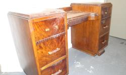 Art deco vanity; three drawers on each side and one in the middle. Use as is for shabby chic look or refinish. Pick-up only; downtown Toronto location. Selling to finance my film!