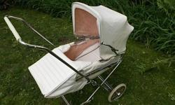 Vintage Baby carriage, folds for storage or transporting, may be good for a photographer.