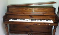 Apartment size Grand piano with good acoustics.