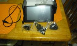 Archos 7 Home tablet with Android Standard USB cable, earphones, power supply, User Guide. 8 gb Hardly used