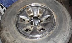 A set of 4 Arctic Claw winter TX1 M+S  235/75 R15 ( 50 % ) on toyota factory chrome rims