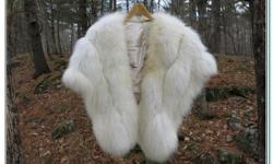 Genuine Arctic Fox. Pelt and fur in exceptional condition. De Rigueur in the 1960s for any well-dressed lady. -Includes Stylish Satin inner lining, a strong closing clasp and comfortable shoulder straps to eliminate slippage. -Owned by my mother. It has