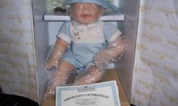 """I have three porcelain dolls for sale from the Joys of Summer Collection by Kathy Barry Hippensteel. These are first issue dolls and are still in the original packaging and have the Certificates of Authenticity. The dolls names that I have are: """"Tickles"""""""