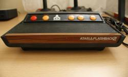 Atari Flashback II works and in excellent condition.    Console with AV Cables 2 Controllers Power Adapter