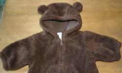 Cute Bear ears on hood & fuzzy material warm & cozy! Fits 0-3 mos (up to 6 mos for my son) In great condition, gently used