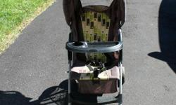 Baby stroller for sale. Comes with a tray and cover.