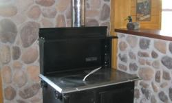 """New Baker's Choice Wood Cookstove This is Suppertime Stoves economy model. If you just have to have a wood cook stove and need it at an affordable price you should consider this stove. FEATURES: Dimensions Length 36"""" Width 24"""" Height 53 1/2"""" Cooking"""