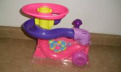 comes with all balls plays music, lots of different songs blows balls in the air