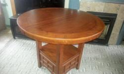"""Bar height table in excellent condition with center leaf. 42 """" diameter top and table stands 35"""" high. In my garage for easy pick-up."""