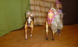 This set has one Barbie, two horses, one saddle for each horse, a cowgirl hat and some extra outfits. You can view or purchase this set at Specially for you uniforms in Duncan.