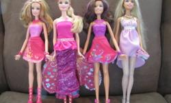 Three dolls from the Fairy Secret Movie & one Fashion Barbie.  You can twist the two Fairy Secret dolls and their skirts become wings.  Other Fairy secret doll has adjustable dress and wings. Will deliver to the Windsor area.