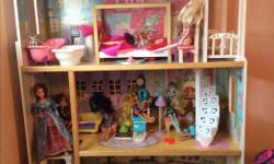 Barbie house for sale. $100 includes the house and the accessories that come with the house...bedroom, living room and bathroom accessories. The barbies in the picture are not included.