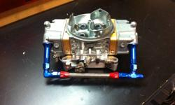 Barry Grant 750CFM Silver Claw Series Performance Carb. *This is the same carb as a Holley HP Series* Fully rebuilt with genuine Barry Grant parts: -          New.110? needle and seats for quick bowl fill -          6.5 Power valve -          Jetting is