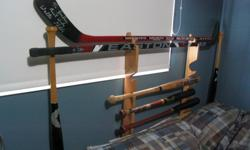 Custom made, one of a kind solid maple, for queen/double bedframe.Can be modified for single bed. Genuine Sam Bat spindles, rack for bats and hocley sticks or golf clubs. items in rack not included