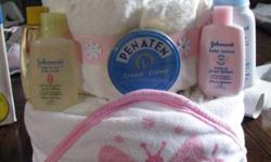 """Making and selling """"Bath Time"""" Diaper Cakes. These include:   -25 Size 2 Pampers Swaddlers -1 Hooded Towel -3 Washcloths -1 Travel size Johnson's Baby Shampoo -1 Travel size Johnson's Head-to-Toe Baby wash -1 Travel size Penaten Cream -1 Travel size"""