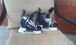Bauer Supreme Pro Hockey Skates, Size 5. Lots of blade and boots in good shape.