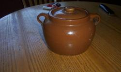 Excellent condition Brownish brown. Lid great bottom of it great. Call 250-679-7782