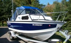2002 Starcraft Islander.135hp I/O. Brand New Engine,0 hrs.18mnth wrnty. Boat is immaculate. - galvanized trailer wih surge brks.,15hp4strk merc kicker,lowrance lcx 18c with GPS,cannon speed temp,brand new top, side curtins, and back enclosure.2 big jon