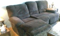 Like new three seat sofa with recliner on each end, scotch guarded, like new