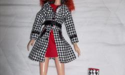 """From a pet free/smoke free home! This beautiful curly red hair doll is quite special with her articulate limb. She comes with funky socks, undies, ,red dress ,black and white coat ornate with a belt and matching rain boots. Approx 13"""" Asking $10.00"""