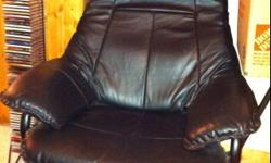 Like new condition! No wear and tear on this chair at all. Hate to sell but won't fit in basement anymore. Lightweight design, but very sturdy as well. Very comfortable, comes with matching foot rest. Black in colour. Firm price. Please call Julie