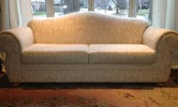 Absolutely beautiful couch and matching loveseat (pillows not included) for sale . We are moving and cannot take them with us. They are 'tone on tone' beige with a subtle floral pattern throughout. We have a selection of throw pillows and two roll pillows