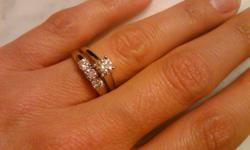 Engagment Ring is 0.5ct round cut, I clarity, set in 14k white gold.  Wedding band is set with 3 0.16 ct round cuts, H/I clarity, set in a 14k white gold band, a 1/2 carat in total. Both rings cost $3450 (I have reciepts), I am asking $1950 obo.  Do not