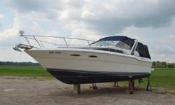 Beautiful Estate Sale : 1989 (30?) 300 Sea Ray (Weekender), fully canopied, carpeted throughout, 2 sleeping quarters, (bow & aft).Bathroom with sink, toilet (with macerator),shower. Cold and hot water and air conditioning. Kitchen has fridge,