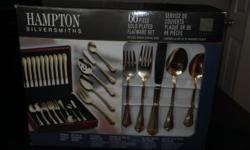 Absolutely stunning 66 pieces,gold plated flatware set.  includes wooden storage chest,still in box,never displayed or used.  regular price $399.00+tax  asking $160.!!    Cell(705)794-1669