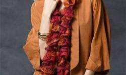 Christmas is quickly approaching! Are you at a loss as to what to get for mom or sister, cousin, or that great friend? Take a look at these gorgeous hand knit ruffled scarves. Fresh and feminine, with a flair of modern style. The subtle hint of silver