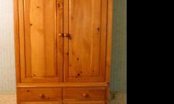 Hand carved Broyhill pine armoire, measures 6 1/2' high by 3' 4 in. wide, 1' 21 in. deep; Includes top shelf; 2 panel (sliding) doors; 1 middle drawer; 2 panel doors at bottom for extra storage. Can be used for bookcase, storage, TV, clothing, linens etc.