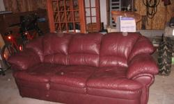 BEAUTIFUL COMFORTABLE LEATHER SOFA FOR SALE, GREAT ADDITION TO YOUR HOME, FAMILY ROOM OR MAN-CAVE. $200. PLEASE CONTACT AS WILL BE GONE IF YOU DO NOT ACT NOW... THE PICTURES DO NOT DO JUSTICE TO THIS ITEM.  THE COLOUR IS MORE OF A DARK BURGUNDY ALMOST