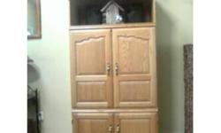 """Beautiful Solid Oak Entertainment with a 27"""" GE Colour Television included. The unit was over $900.00 when purchased!   Is in excellent condition.   Dimensions of Unit: Height 72 inches Width 35 1/2 inces Depth 20 inches   27"""" GE Colour Television"""