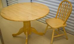 Non smoker. Excellent condition (no stains/scratches). Solid wood. Includes 4 sturdy chairs and cushions. 42 inches round - with both leaves extended 24 inches - middle section. 30 inches tall