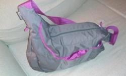 Beautiful quality Lowepro passport sling camera bag, like new condition. grey and purple lining.