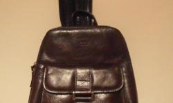 Style and functionality come together in this fashionable genuine leather Veneto bag. Strap un-zips for backpack hands free use. Dark brown, real leather, never used. Purchased at Toronto Pearson Airport. $30.00