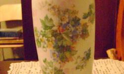 Vintage vase is in very good condition. There is a delicate floral design on the front of the piece that is in great shape. The vase was made at the IPF Ilmenau Porcelain Factor in Thuringia, Germany. The mark on this piece was used between 1903 through