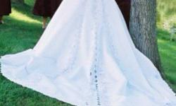 I have a beautiful plus size wedding gown for sale at a fantastic price! I paid over $1500 for it. It is short sleeved with a scalloped neckline. It has beading and lace top, satin skirt and lace edging around the bottom. The train is long with lace