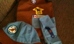 this is a medium sized vest; hat; neckerchief and neckerchief slide. It's everything you need to start Beavers.