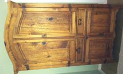 Beautiful wormwood bedroom set.  Includes armoire, 2 bedside dressers, headboard, footboard and railings.  Must sell..no room.  Set in excellent condition.