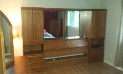 Downsizing and selling a 3 piece bedroom set in solid wood .It is in excellent condition The set is worth $1800, but asking $325. Head board has two attached night tables, and shelving for ample storage. Two dressers: chest of drawers with mirror and tall