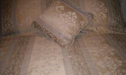 FOR SALE..Queen size bedspread, bedskirt, 2 pillow shams and a decorator pillow.gold colour..in excellent condition  $45.00 for the set. obo