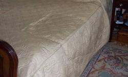 Gold or beige custom made quilted bedspreads for 2 twin beds. Would also work on King Size bed that?s 72? wide with overlapping.   Pictures don?t show well for colour and it?s on my Queen Size bed with a foot board so it doesn?t suit. They were made for a