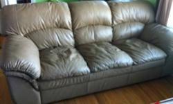 Beige leather couch in good condition. Will throw matching chair in for free but the chair shows some wear and tear ( see picture 4 and 5) This ad was posted with the Kijiji Classifieds app.