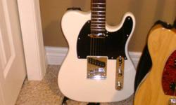 very beuatiful white telecaster brand new. ive only played it 3 times! i must sell it because i need the cash and i play my other guitar more. its new in the box, custom hand made and comes with a pick it would make an awesome christmas or birthday