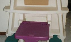 """very big art and craft center, 39"""" tall x 39 wide, has swing out 2 green chair and pull out purple desk, lots of build-in shelf to store the supplies, back has chalkboard ( blue ), also has build -in slot for the chalks. on top of the center, there is"""