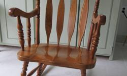 Better quality rocking chair.( paid $300.00) Very good conditiion and a solid chair. Big enough to fit a large man. My grandchildren are too big to rock anymore.