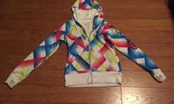 Girls' BILLABONG Zip-up Hoodie Size: LARGE - multi-colour with seaming at cuff and thumb holes to keep hands warm - front pocket - screenprint on sleeve - 80% polyester, 20% cotton - in very good condition; some staining at cuffs - smoke free, pet free