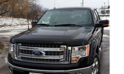 Make Ford Model F-150 SuperCrew Year 2014 Colour Black kms 20000 Black 2014 Ford F150 XLT SuperCrew 4x4 Mint Condition 20,000 KM 5.L v8 Towing Package Chrome Running Boards Rear View Camera Metal Tonneau Cover by Peragon Sprayed in rubber bed liner and